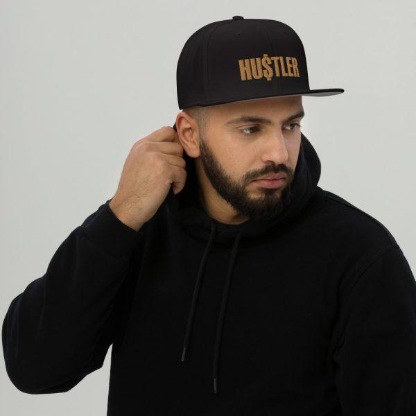 Guy Wearing Gold Hustler Hat