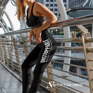unstoppable fitness girl wearing woman leggings leaning on a metal handrail